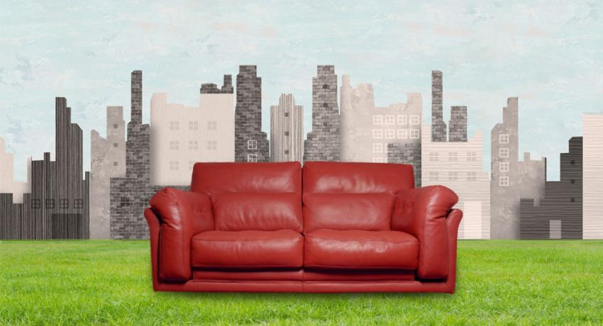 Couch in front of a city skyline